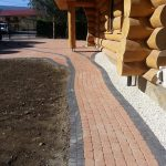 reb brick block paving at a log cabin