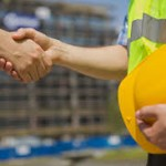handshake with yellow hard hat